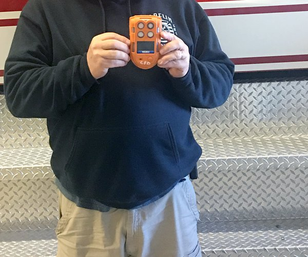 biz_vlc_Claflin fire chief with gas monitor.jpg