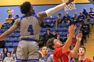 Barton's Deandre Bowles goes up for a bucket